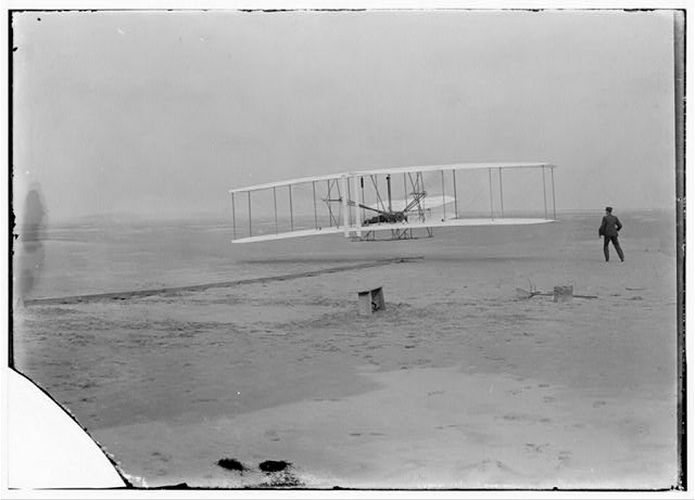 "Here's a description of ""First Flight"" photograph from the Wright Brothers"